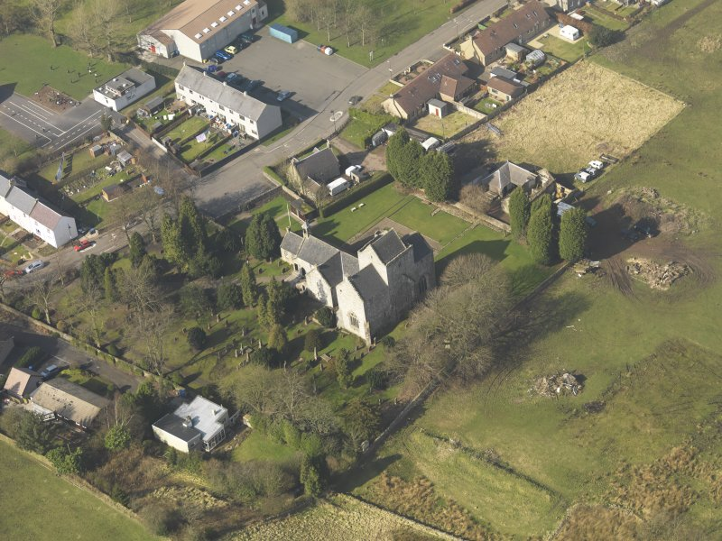 Oblique aerial view centred on the Preceptory and parish church, taken from the SE.