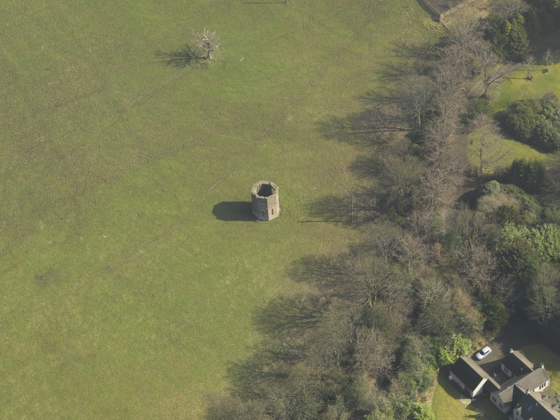 Oblique aerial view centred on the dovecot, taken from the NW.