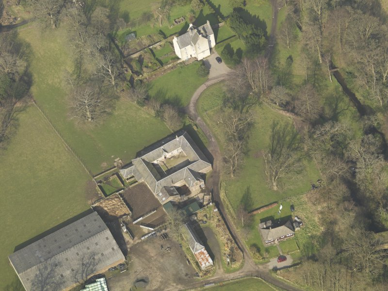 Oblique aerial view centred on the Home Farm with Old Leckie house adjacent, taken from the SSW.