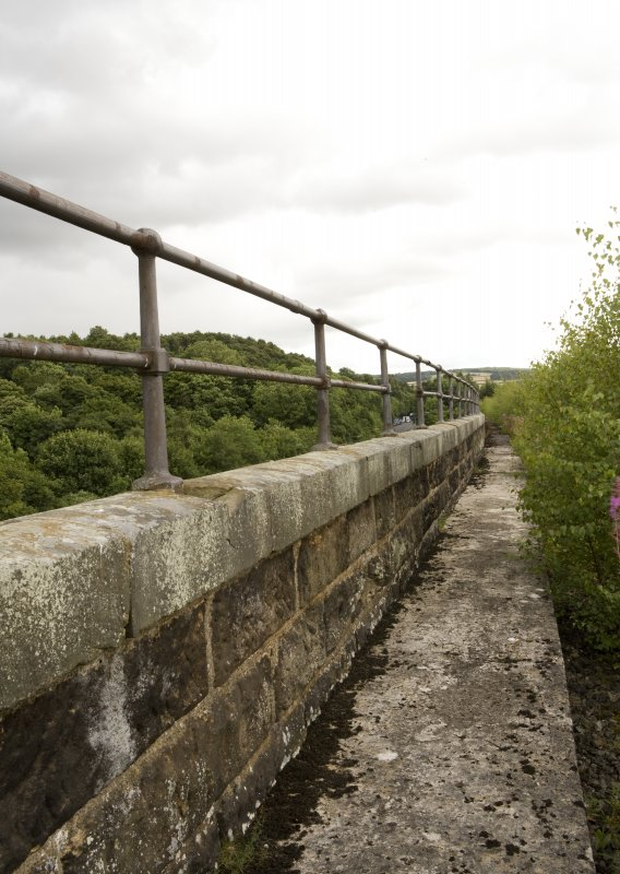 Detail of S side bridge parapet, walkway and handrail.