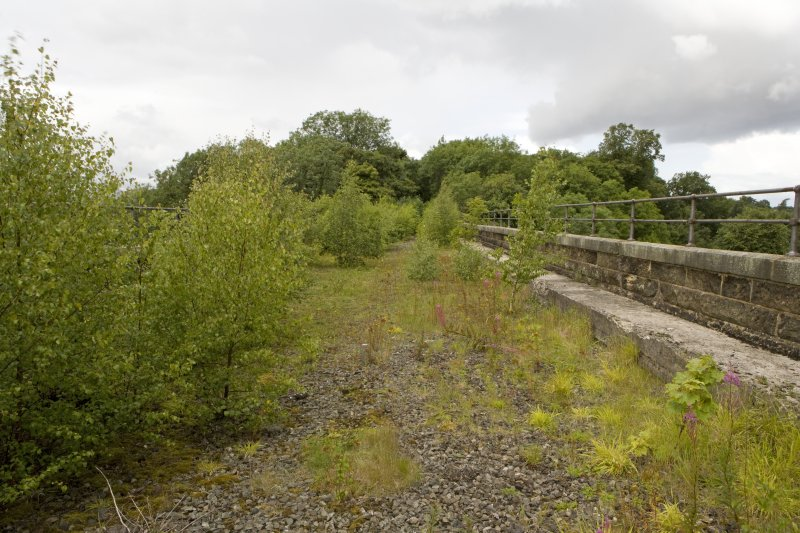 General view of bridge deck with N parapet showing surviving ballast.
