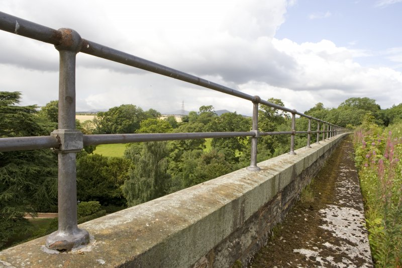 Detail of S side bridge parapet and handrail showing raised walkway.