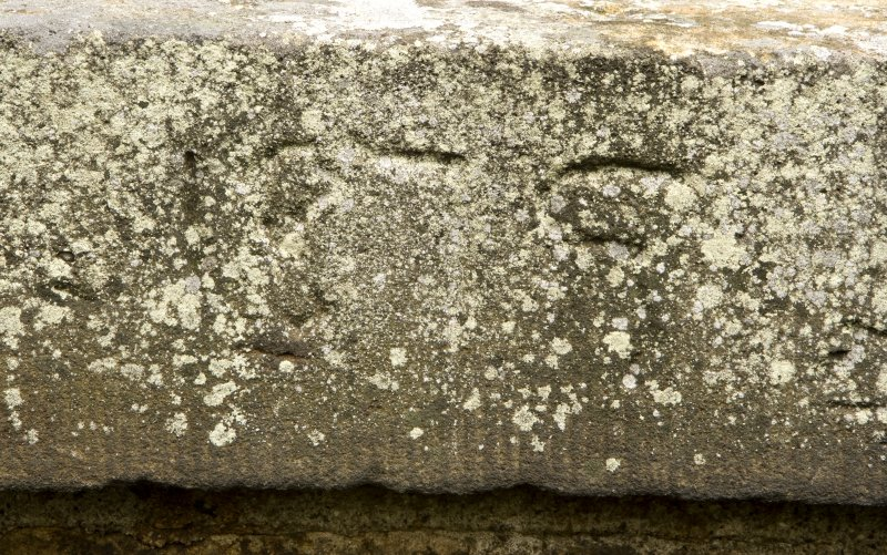 Detail of possible inscribed date on N parapet.