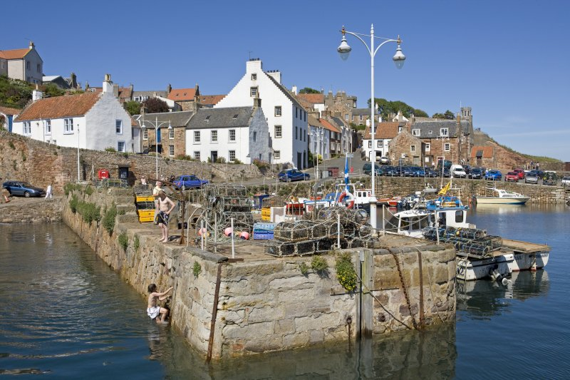 View of W wall of harbour, Crail, from SSW