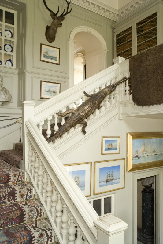 Interior. Stair hall, view from half landing to NE