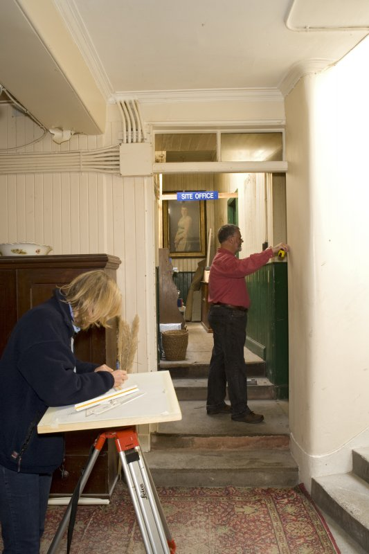 Interior. Ground floor, Heather Stoddart and John Borland carrying out measured survey