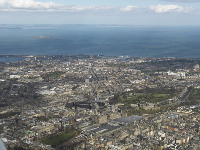 General oblique aerial view of Edinburgh centred on Waverley Station, taken from the SSW.