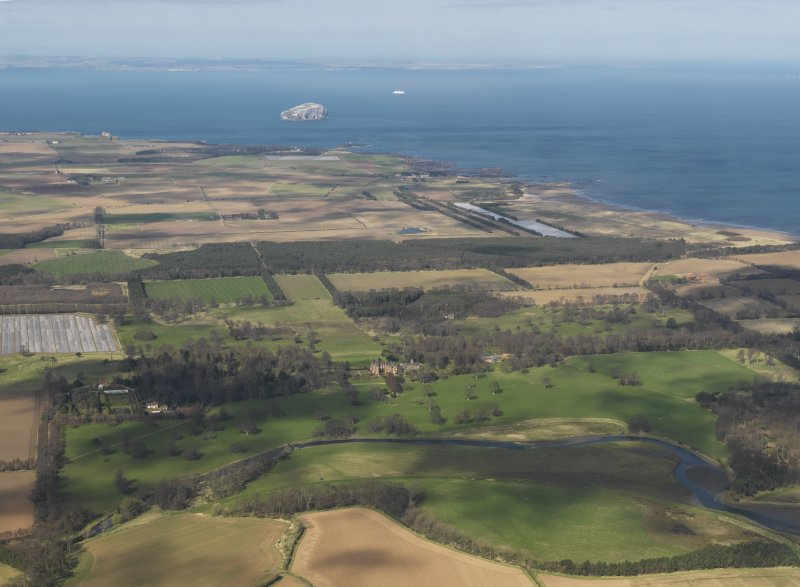 General oblique aerial view looking across Tyninghame House with the Bass Rock in the distance, taken from the SSE.