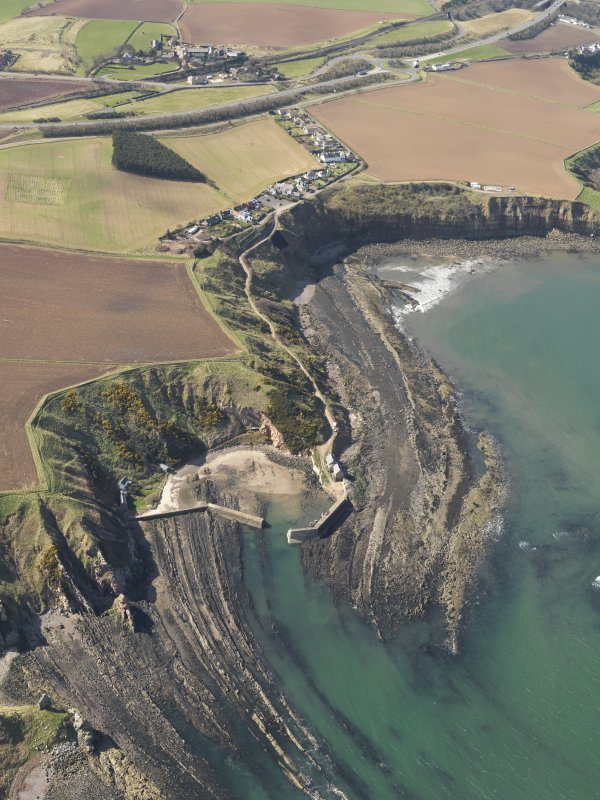 Oblique aerial view of Cove Harbour, Berwickshire, taken from the E.