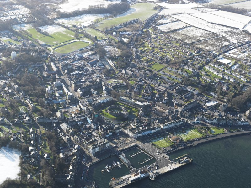 General oblique aerial view of Rothesay centred on the castle, taken from the NE.