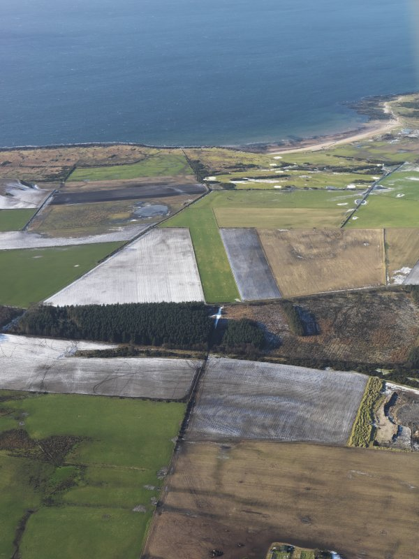 General oblique view looking towards Stravannan Bay looking along Bute airfield, taken from the E.
