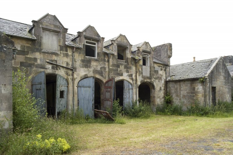 Stable block, view of cartsheds from N
