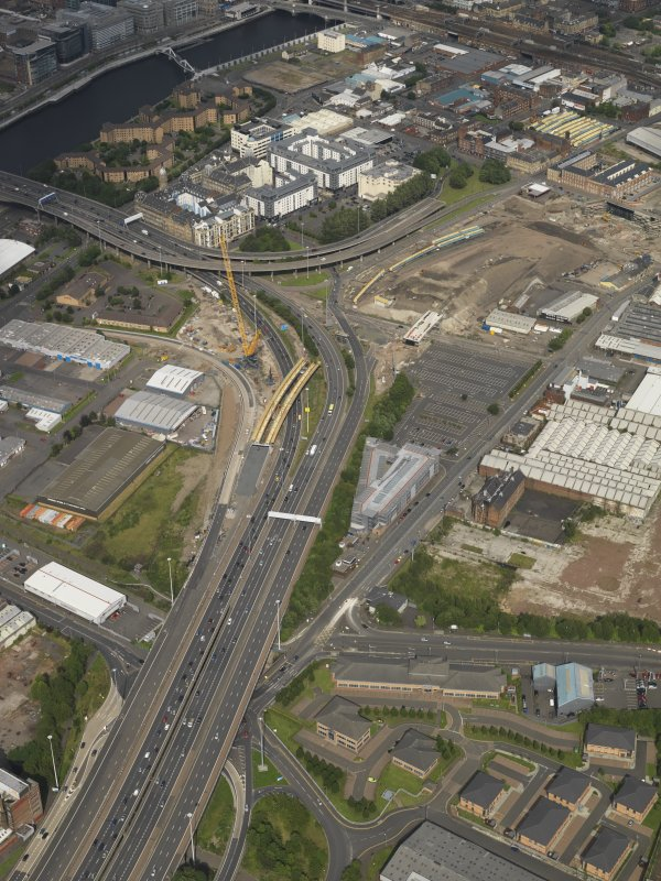 Oblique aerial view of the M74 extension centred on the junction with the M8 at the Kingston Bridge, taken from the WSW.