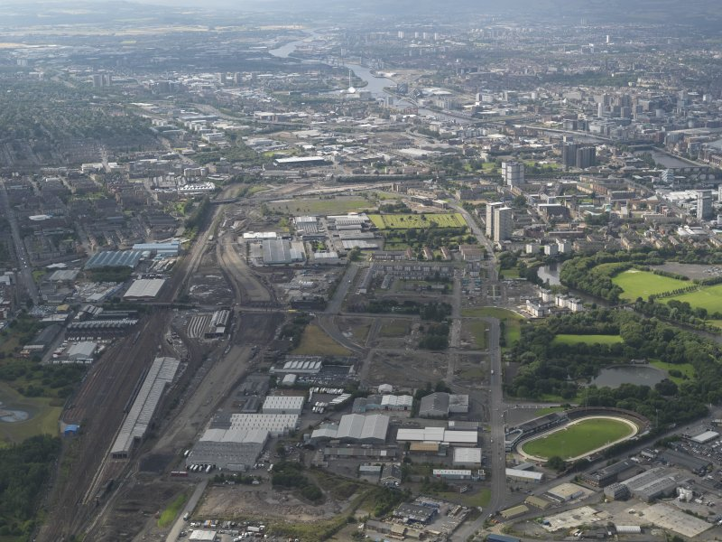 General oblique aerial view of the M74 extension looking towards the centre of Glasgow across the Polmaddie area, taken from the ESE.