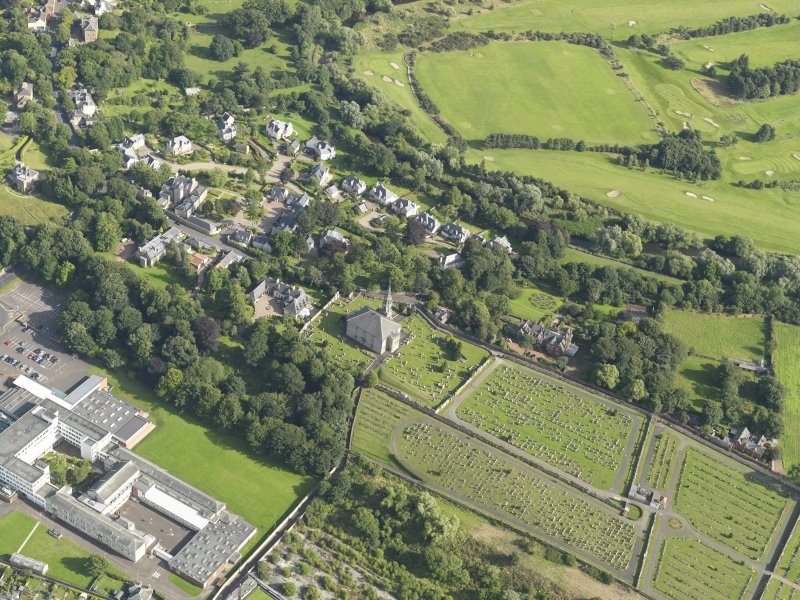 Oblique aerial view of Inveresk Parish Church and the site of the Roman Fort, taken from the NNE.