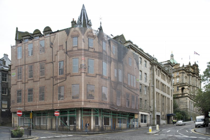 View of the Market Street building with facade print covering over the scaffold, taken  from north east