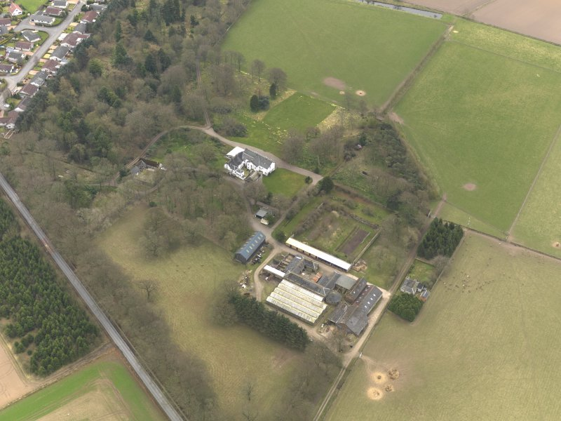 Oblique aerial view centred on the country house with the tower-house adjacent, taken from the NW.