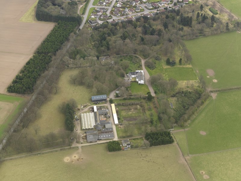 Oblique aerial view centred on the country house with the tower-house adjacent, taken from the WSW.
