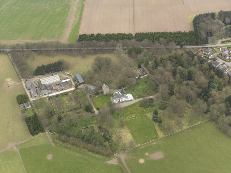 Oblique aerial view centred on the country house with the tower-house adjacent, taken from the SSW.
