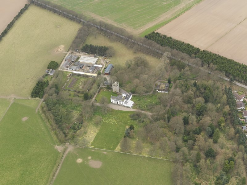 Oblique aerial view centred on the country house with the tower-house adjacent, taken from the SSE.