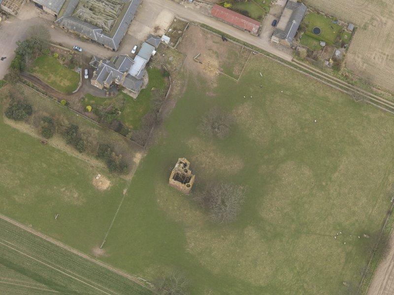 General oblique aerial view centred on the remains of the tower-house, taken from the SW.