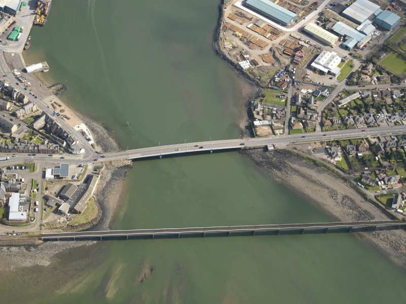 General oblique aerial view centred on the rail and road bridges, taken from the WNW.