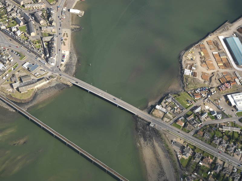 General oblique aerial view centred on the rail and road bridges, taken from the W.