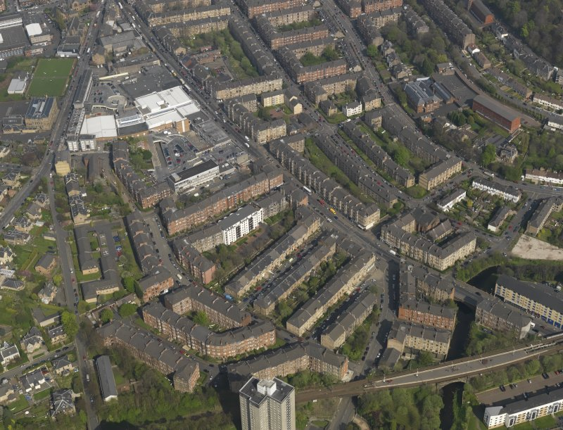 General oblique aerial view centred on the Kilmarnock Road, taken from the SW.