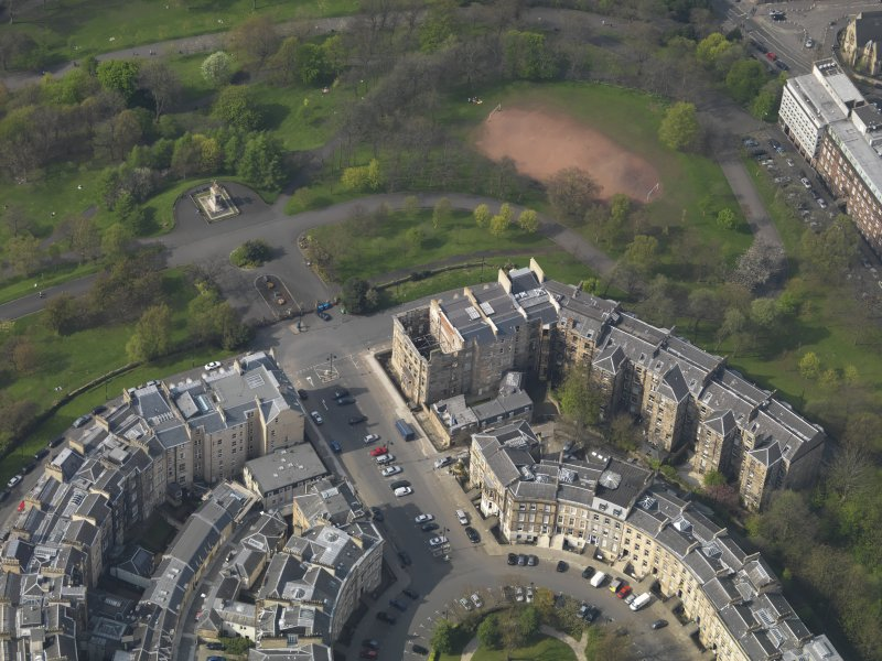 Oblique aerial view centred on the fire damaged tenement, taken from the SE.