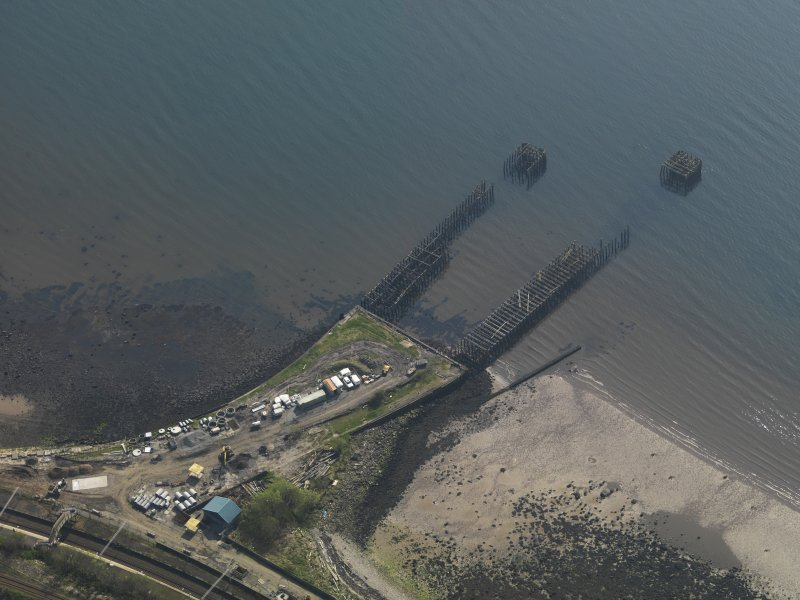 Oblique aerial view centred on the remains of the pier, taken from the N.