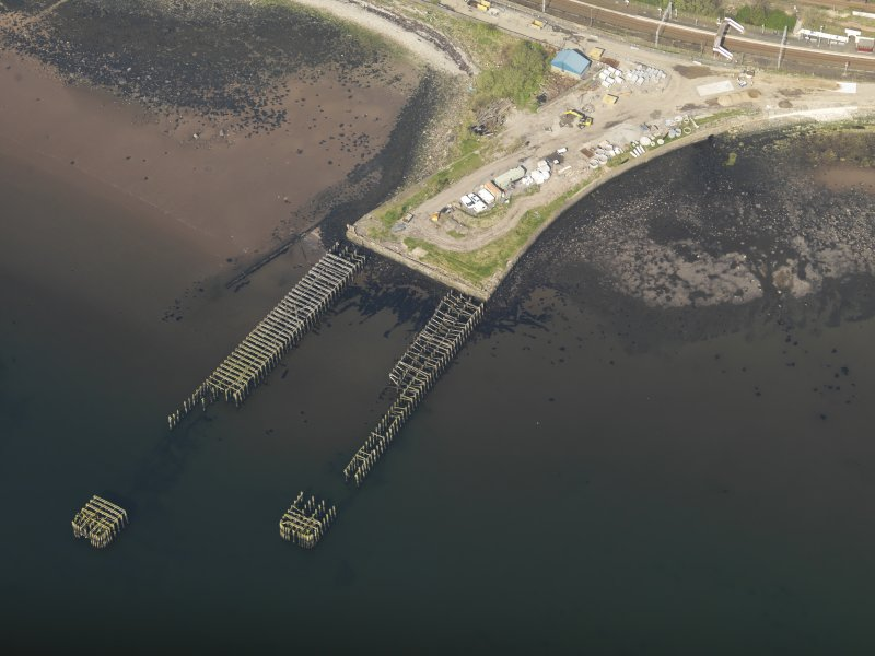 Oblique aerial view centred on the remains of the pier, taken from the SW.