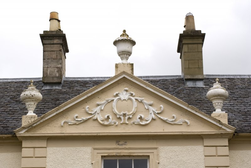 Detail of pediment above main entrance