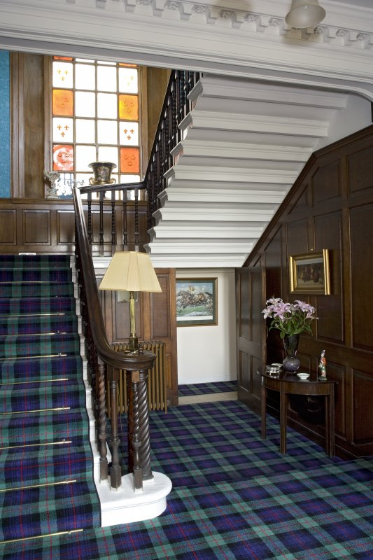Interior. Ground floor, entrance hall, view of staircase from SSE
