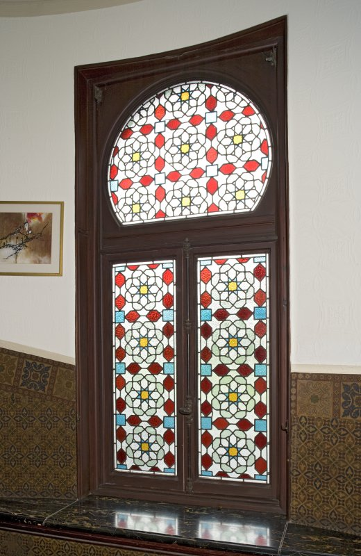 Interior. Ground floor, hall, detail of stained glass window at foot of stairs