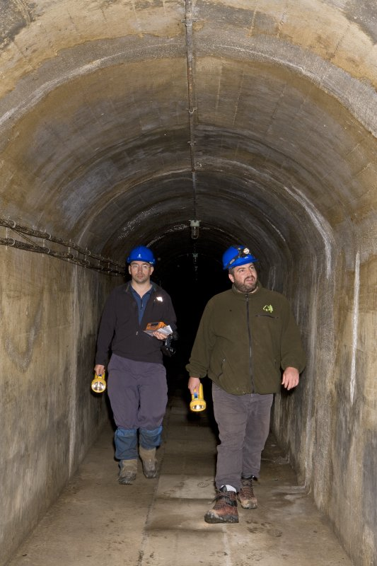 Interior, within access tunnel, Mr Allan Kilpatrick (RCAHMS) and Mr Matt Ritchie (Forestry Commission) exitiing.