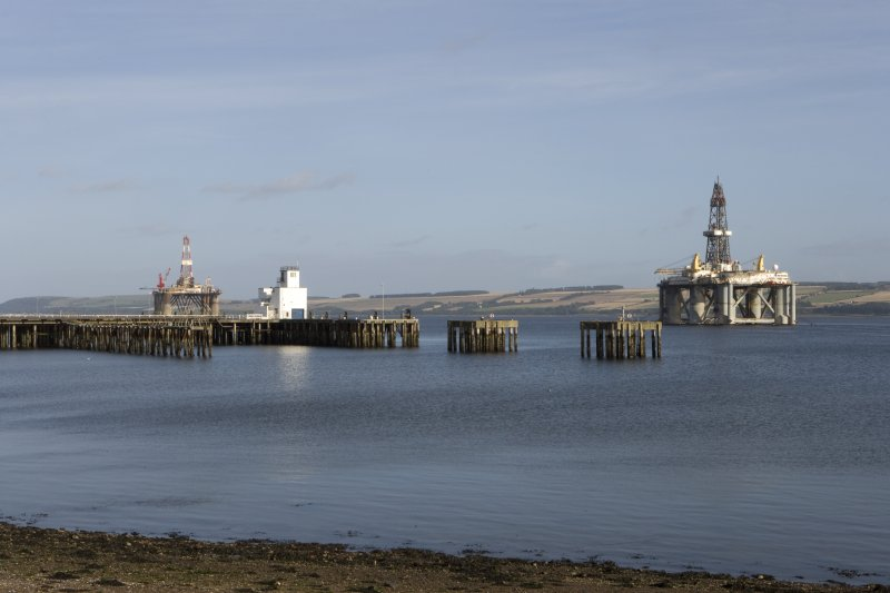General view from NW of pier, control tower and oil rig.