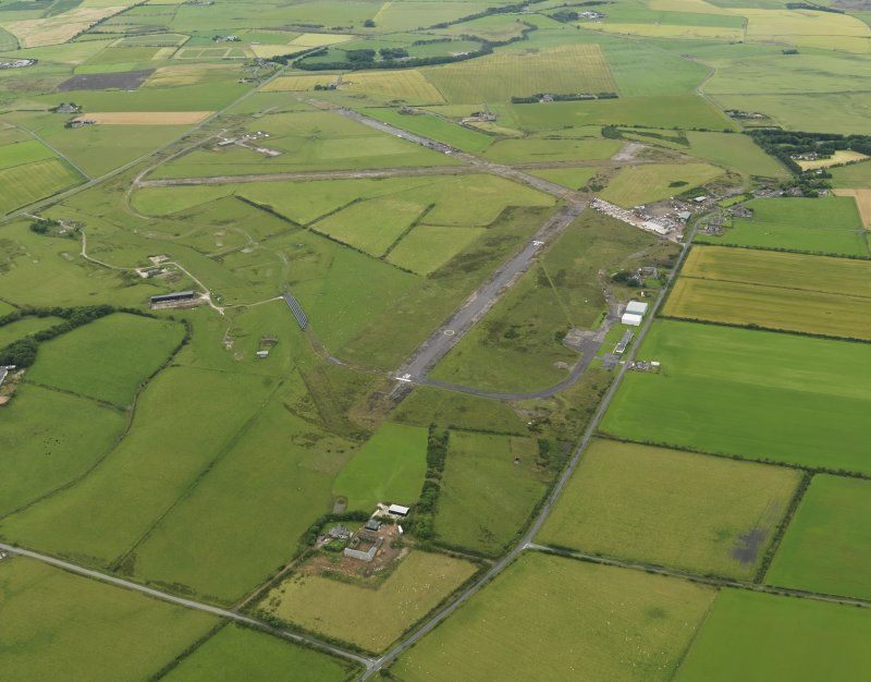 General oblique aerial view centred on the airfield, taken from the E.