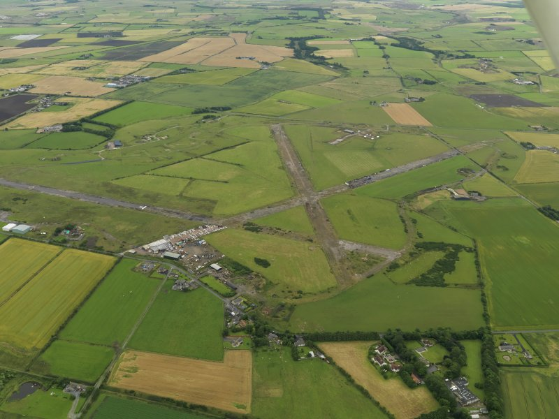 General oblique aerial view centred on the airfield, taken from the N.