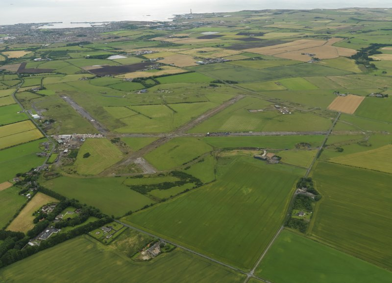 General oblique aerial view centred on the airfield, taken from the WNW.