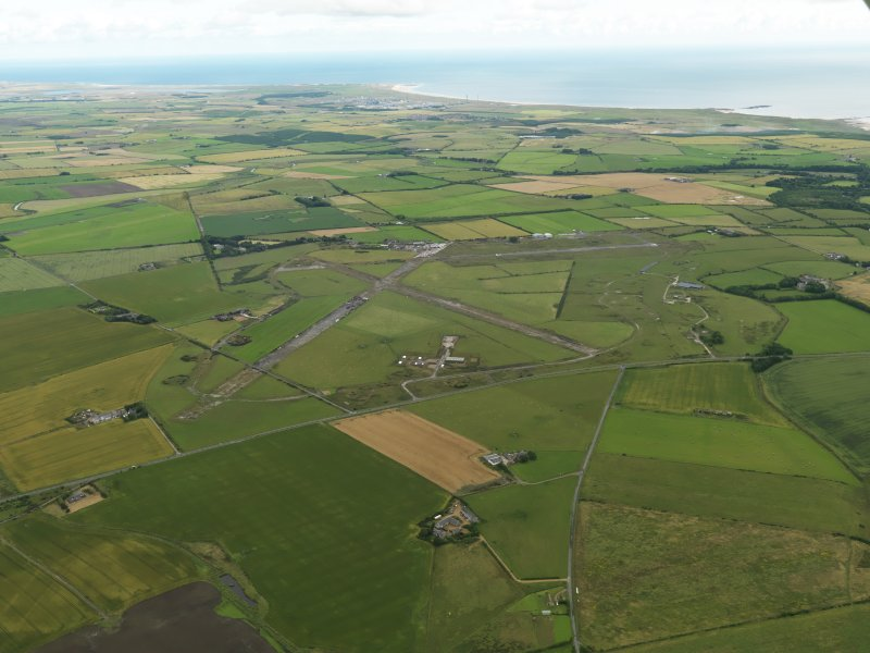 General oblique aerial view centred on the airfield, taken from the SSW.