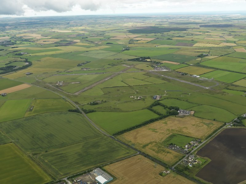 General oblique aerial view centred on the airfield, taken from the SE.