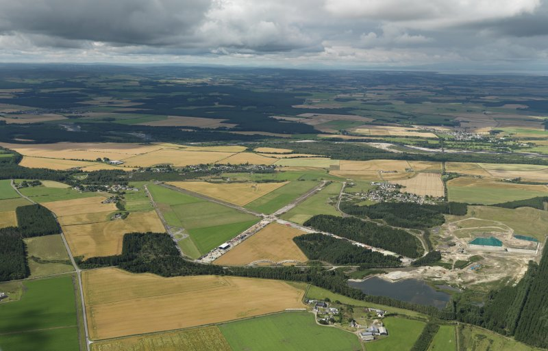 General oblique aerial view centred on the remains of the airfield, taken from the E.