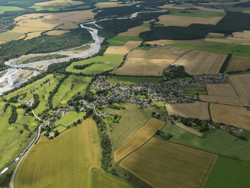 General oblique aerial view centred on the village, taken from the NNW.