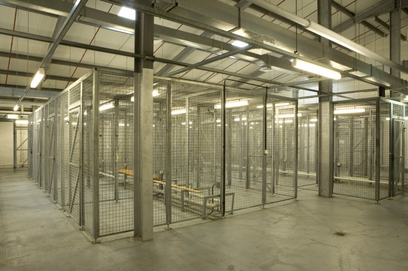 Interior of NSWU 2 operations building showing individual personnell kit storage cages.