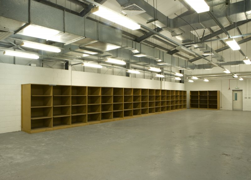 Interior view of NSWU 2 building packing hall with storage shelves/boxes.
