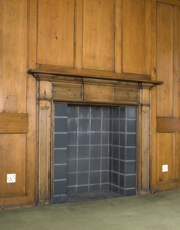 Interior. Panelled entrance room, detail of fireplace
