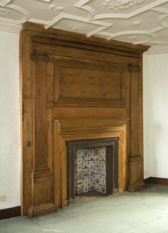 Interior. Upper floor plaster ceiling room, view of main fireplace