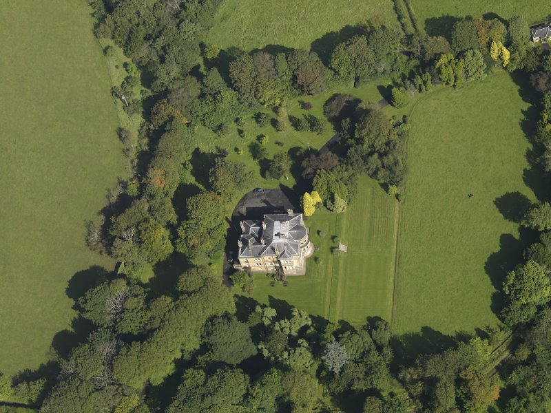 Oblique aerial view centred on the house, taken from the SSE.