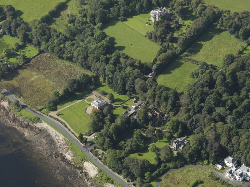 General oblique aerial view looking towards the house, taken from the NE.
