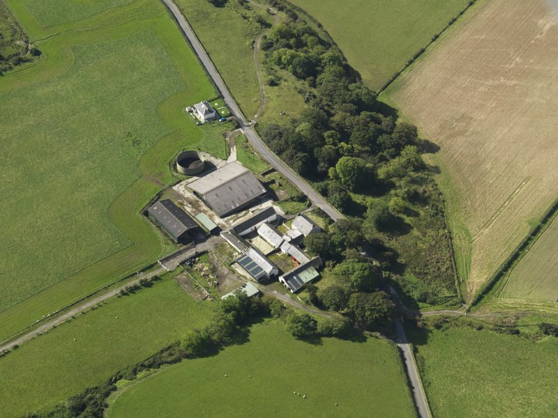 Oblique aerial view centred on the farmsteading, taken from the NNE.